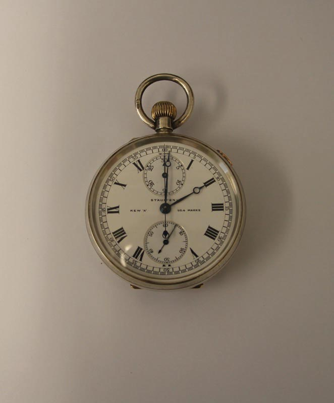 A silver stopwatch presented to F Lindsay Lloyd by H Locke King