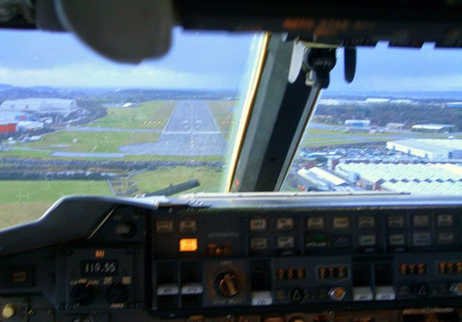 View from inside the cockpit coming in to land on a runway