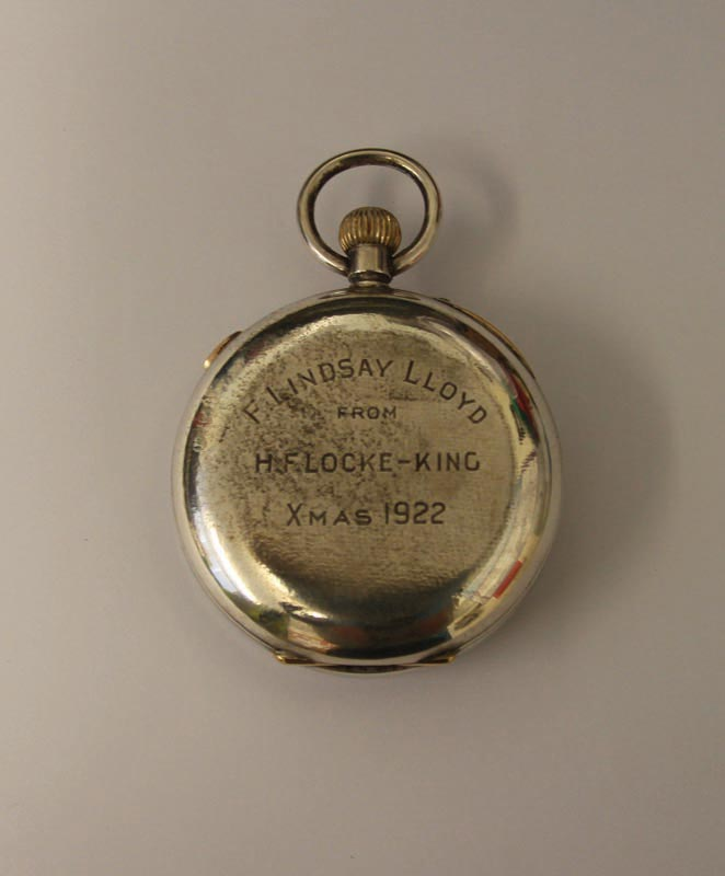 A silver stopwatch with inscription presented to F Lindsay Lloyd by H Locke King